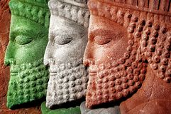 Persepolis. Iran. Ancient Persia. Bas-relief carved on the walls of old buildings. Colors of national flag of Iran Stock Images