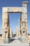 Persepolis. Iranian tourists are passing throught the Gate of All Nations, Persepolis, Iran. It is the entrance of the Western wall and reflect the Empire's Stock Photos
