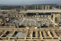 Persepolis, The Palace of 100 Collumns. Persepolis, view from the hill on palace of 100 columns, in the background right is Apadana Palac, Palace of Xerxes and Royalty Free Stock Image