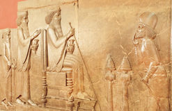 Persepolis relief with historical scene and king Darius in National Museum Royalty Free Stock Image