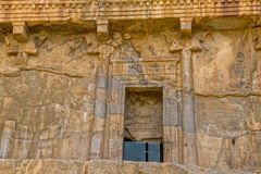 Persepolis royal tombs door. Royal tombs entrance door on the hill in old city Persepolis, a capital of the Achaemenid Empire 550 - 330 BC Stock Photos