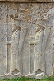Persepolis: Soldiers carvings Stock Images