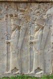 Persepolis: Tjäna som soldat carvings Arkivbilder