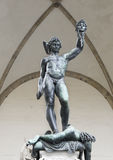 Perseus with the Head of Medusa. Is a bronze sculpture made by Benvenuto Cellini in 1545. The sculpture is located in the Loggia dei Lanzi of the Piazza della Royalty Free Stock Images