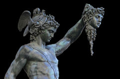 Perseus holding the head of Medusa on black background,Florence. Detail of  statue of Perseus holding the head of Medusa on black background, Florence, Italy Stock Photography