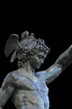 Perseus holding the head of Medusa on black background,Florence Stock Images