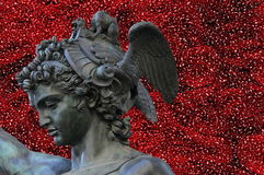 Perseus holding the head of Medusa on red abstract background, Stock Image
