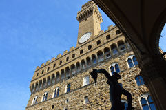 Perseus statue view from Loggia dei Lanzi with Palazzo Vecchio building on the background, Florence, Italy Royalty Free Stock Photos