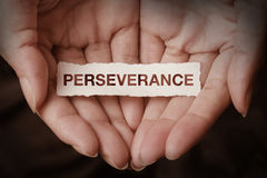 Perseverance text on hand Stock Images