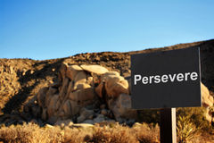 Persevere. A board shot outdoors asking the question Stock Photo