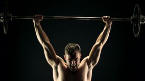 Persevering bodybuilder lifting heavy barbell. stock footage