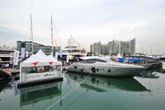 Pershing 64 yacht on display during Singapore Yacht Show at One Degree 15 Marina Club Sentosa Cove Stock Photo