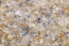Persian Blue Salt crystals closeup, surface and background. Fine rock salt from Iran. Blue color occurs during forming the crystalline structure, caused by an stock image