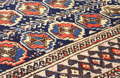 Persian carpet background. Close up of a persian carpet Royalty Free Stock Photo