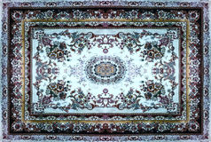 Persian Carpet Texture, abstract ornament. Round mandala pattern, Middle Eastern Traditional Carpet Fabric Texture. Turquoise milk. Y blue grey brown yellow red royalty free stock photo