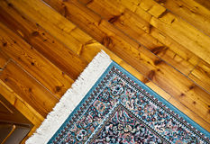 Persian carpet on a wooden floor stock photo