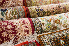 Persian carpets. On display in a carpet store Stock Photos