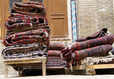 Persian carpets. On the stall in bazaar in Kashan, Iran Royalty Free Stock Images