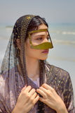 Persian girl in traditional islamic mask of southern Iran, portr. Portrait of a Persian girl in a traditional Muslim mask of southern Iran Royalty Free Stock Image