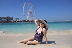 woman girl in big hat sunbathing on beach on sea background Royalty Free Stock Photography