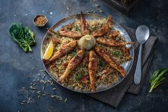 Persian herbed rice sabzi polo with fried red mullet, copy space royalty free stock images