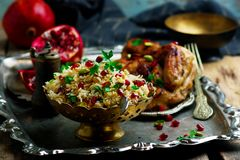 Persian Honey Glazed Chicken and Jeweled Rice. Selective focus Royalty Free Stock Photography