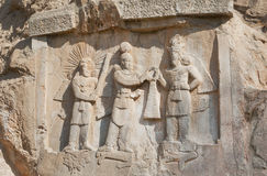 Persian kings on stone relief of the monument Taq-e Bostan in Iran. Taq-e Bostan is rock relief from 4 century Royalty Free Stock Image