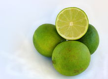 Persian Limes. On white background Stock Images