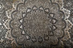 Persian metal engraving. A close up image of a Persian metal engraving royalty free stock photos