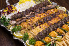 Close up of Persian Mix Kebab consist of minced meat chicken and steak with rice in large tray  Stock Photography