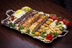 Close up of Persian Mix Kebab consist of minced meat chicken and steak with rice in large tray  Stock Images