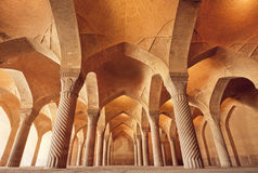 Persian mosque Vakil with carved columns in huge historical hall, Iran Stock Image