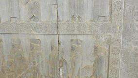 Persian noblemen relief detail Persepolis. Persian noblemen on their way to the royal feast bas-relief detail on the stairway facade of the Apadana at the old stock video