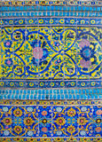 Persian patterns on the beautiful walls of the old mosque in Iran Stock Image