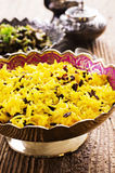 Persian Rice with Saffron and Barberries. As closeup in a traditional bowl Stock Photos