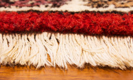 Persian rug in the bedroom. Persian red rug in the bedroom Stock Photos