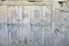 Persian warriors armed, bas relief in Xerxes palace, Persepolis, Royalty Free Stock Photography