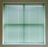 Persianas de ventana verdes Imágenes de archivo libres de regalías