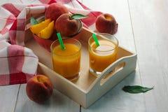 Persikafruktsaft Arkivfoto