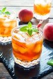 Persikan iced tea Royaltyfri Foto