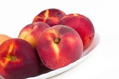 persikor plate white Fotografering för Bildbyråer