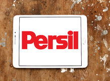 Persil laundry detergent logo. Logo of persil laundry detergent or washing powder on samsung tablet on wooden background Stock Images