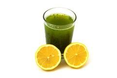 Persilja och citronjuice som oljer calore Arkivbild