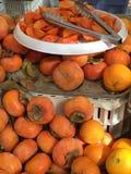 Persimmon στην αγορά των στο κέντρο της πόλης αγροτών του San Jose Στοκ Εικόνες