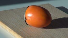 Persimmon φρούτα Ορεκτικός φρέσκος χορτοφάγος απόθεμα βίντεο