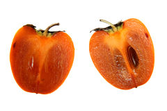Persimmon. Two halves of a ripe persimmon on a white background Stock Image