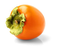 The persimmon. On a white background Royalty Free Stock Photography