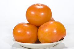 Persimmon. Pure and fresh and sweet fruit, white background Stock Photos