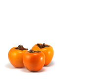 Persimmon. Orange persimmon isolated on a white background Stock Photography
