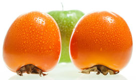 Persimmon and apple Royalty Free Stock Photography